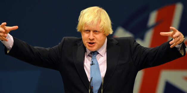 London Mayor Boris Johnson addresses delegates at the annual Conservative Party Conference in Manchester,...