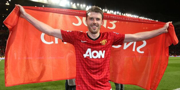 MANCHESTER, ENGLAND - APRIL 22: Michael Carrick of Manchester United celebrates at final whistle of the...