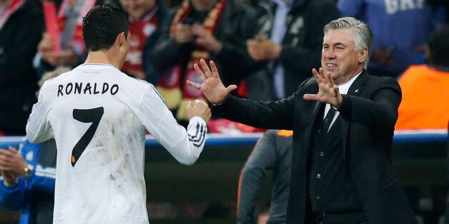 MUNICH, GERMANY - APRIL 29: Cristiano Ronaldo (L) of Real Madrid celebrates after scoring his team's...