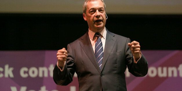 BATH, ENGLAND - APRIL 29: UK Independence Party leader Nigel Farage enjoys a pint at the Volunteer Rifleman's...