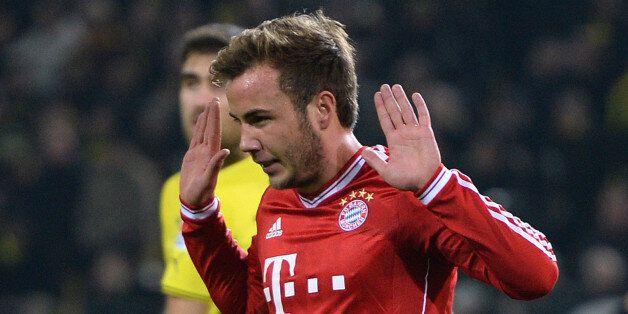 DORTMUND, GERMANY - NOVEMBER 23: Mario Goetze of Munich celebrates after scoring the opening goal during...