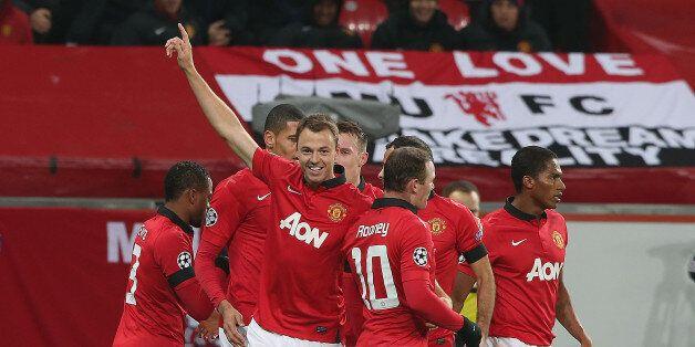 LEVERKUSEN, GERMANY - NOVEMBER 27: Jonny Evans of Manchester United celebrates scoring their third goal...