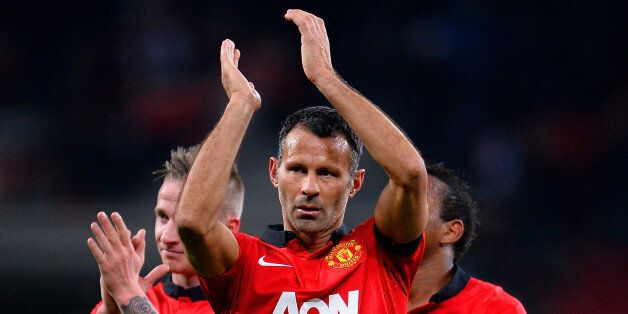 LEVERKUSEN, GERMANY - NOVEMBER 27: Ryan Giggs of Manchester United applauds the fans during the UEFA...