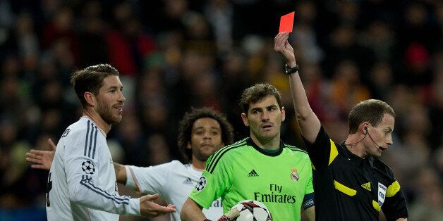 MADRID, SPAIN - NOVEMBER 27: Referee William Collum shows the red card to Sergio Ramos of Real Madrid...