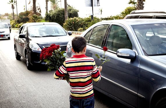 The Gardenia Boys: 10-Year-Olds Standing Alone on Street Corners Selling Flowers at