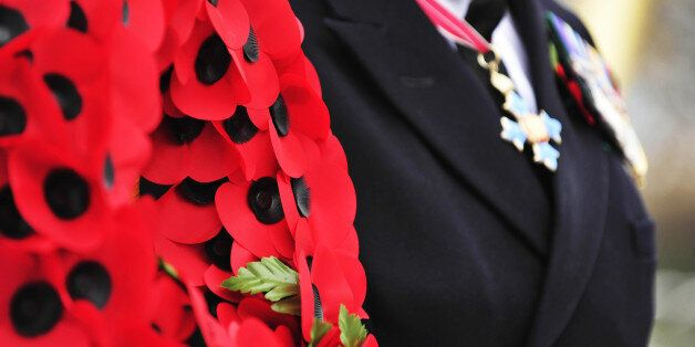 A wreath of poppies are held at the launch of this year's poppy appeal on HMS Somerset, at Avonmouth...
