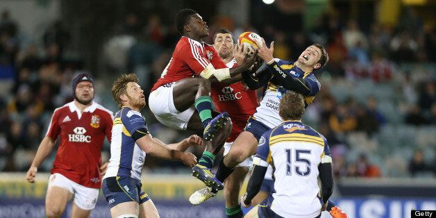 Christian Wade of the Lions competes for the ball in the air with Ian Prior of the Brumbies during the...