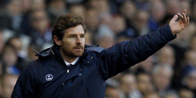 Tottenham Hotspur's Portugese manager Andre Villas-Boas (R) gestures beside Manchester United's Scottish...