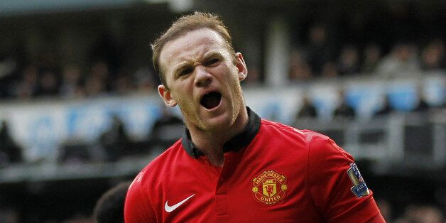Manchester United's English striker Wayne Rooney celebrates scoring his second goal from the penalty...