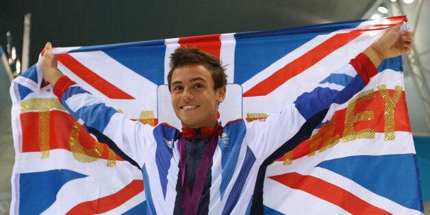 LONDON, ENGLAND - AUGUST 11: Bronze medallist Tom Daley of Great Britain poses with the national flag...