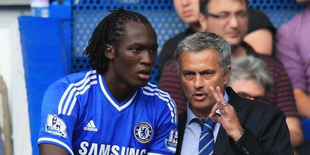LONDON, ENGLAND - AUGUST 18: Chelsea manager Jose Mourinho talks to substitute Romelu Lukaku of Chelsea...