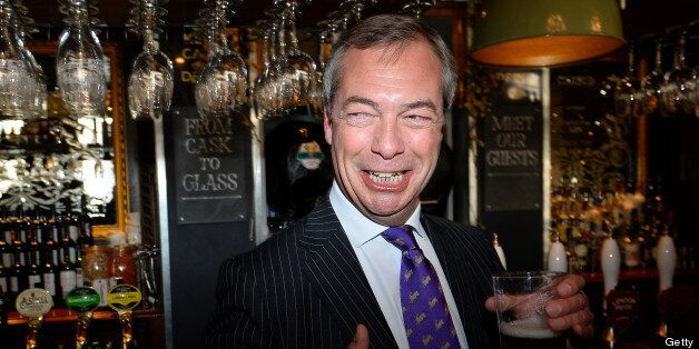 UK Independent Party (UKIP) leader Nigel Farage enjoys a pint of beer in a pub in central London on May...