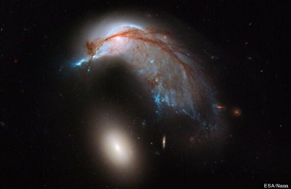 Hubble Telescope Reveals 'Cosmic Penguin' As Two Galaxies Collide In Space