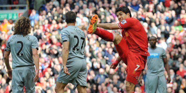 Liverpool's Uruguayan striker Luis Suarez (2nd R) celebrates his team's second goal after Liverpool's...