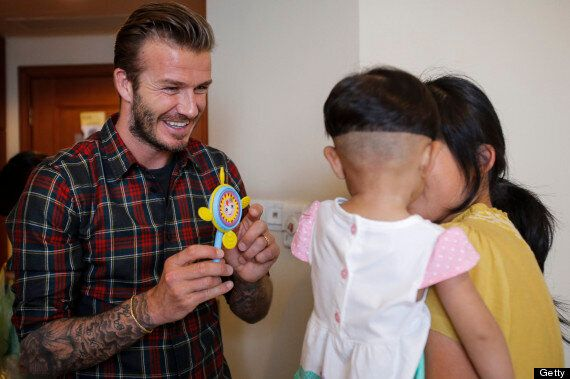 David Beckham Melts Hearts As He Pulls Silly Faces With Children During China Hospital Visit