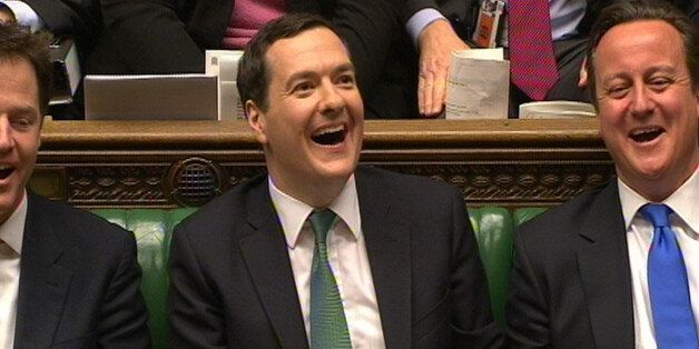 Chancellor of the Exchequer George Osborne and Prime Minister David Cameron react as Shadow Chancellor...