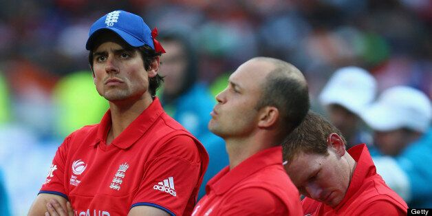 BIRMINGHAM, ENGLAND - JUNE 23: Alastair Cook (L) captain of England looks on dejectedly during the trophy...