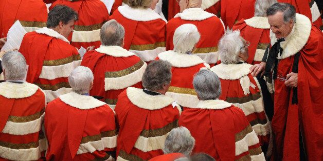 Peers wait in in the House of Lords, London, for the arrival of Queen Elizabeth II and the Duke of Edinburgh...