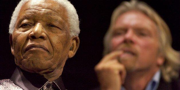 SOUTH AFRICA - JULY 18: Former South African President Nelson Mandela, left, and U.K. billionaire Richard...