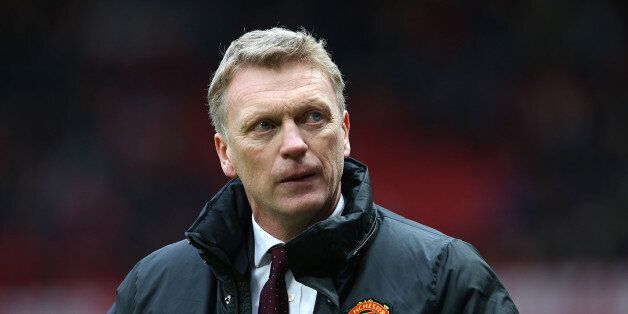 MANCHESTER, ENGLAND - DECEMBER 07: Manager David Moyes of Manchester United walks off after the Barclays...