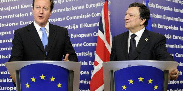 European Commission president Jose Manuel Barroso (R) and British Prime Minister David Cameron give a...