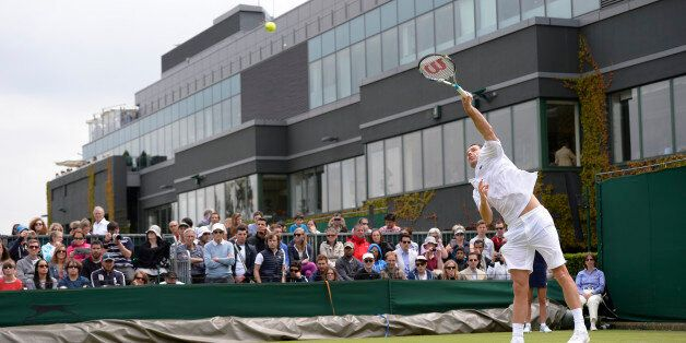 France's Michael Llodra serves against Italy's Andreas Seppi during their second round men's singles...