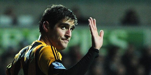SWANSEA, WALES - DECEMBER 09: Hull striker and former Swansea player Danny Graham (r) apologises to the...
