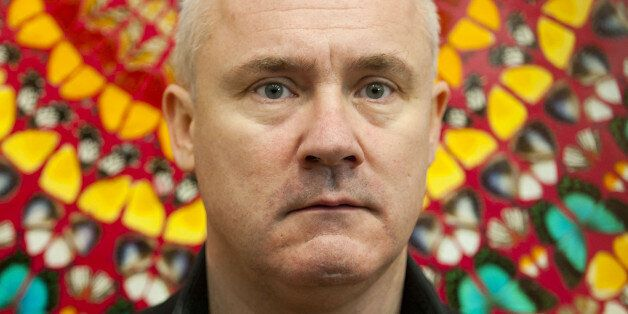 Artist Damien Hirst pictured in front of his work I Am Become Death, Shatterer of Worlds, on display...