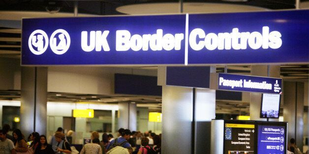 Border Control in Terminal Five of London's Heathrow Airport where some immigration and customs staff...