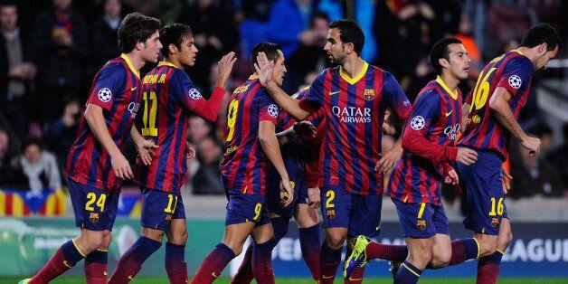 BARCELONA, SPAIN - DECEMBER 11: FC Barcelona players celebrate after Gerard Pique of FC Barcelona scored...