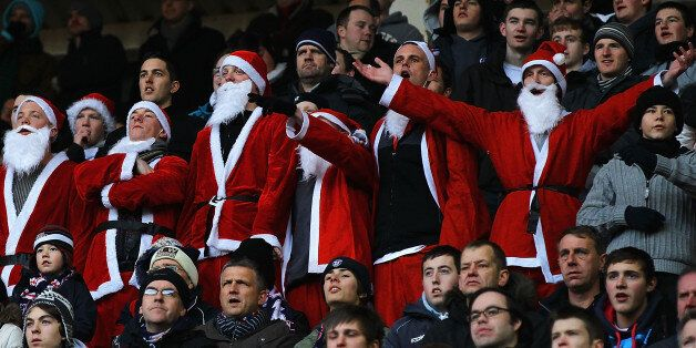 SUNDERLAND, ENGLAND - DECEMBER 18: Bolton Wanderers supporters dressed as Santa Claus watch from the...