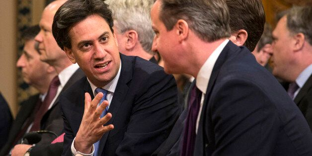 British opposition Labour Party leader, Ed Miliband (L) speaks with British Prime Minister, David Cameron...