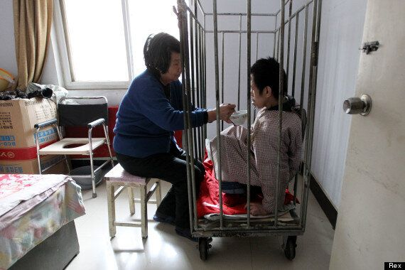 Mother Keeps Brain Damaged Chinese Man In Cage For 40 Years