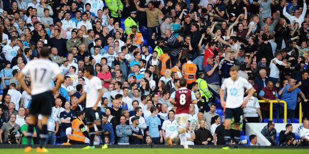 LONDON, ENGLAND - OCTOBER 06: West Ham fans celebrate their side's second goal during the Barclays Premier...