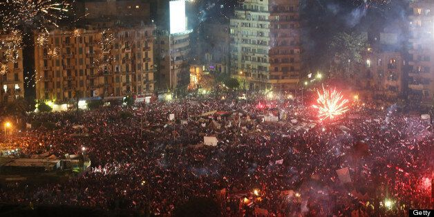 CAIRO, EGYPT - JULY 03: Fireworks and shouts of joy emanate from Tahrir Square after a broadcast by the...
