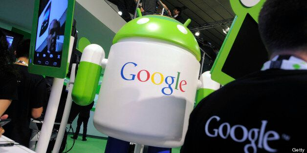 An Android operating software icon sits on display with a Google Inc. logo at the Google booth at the...
