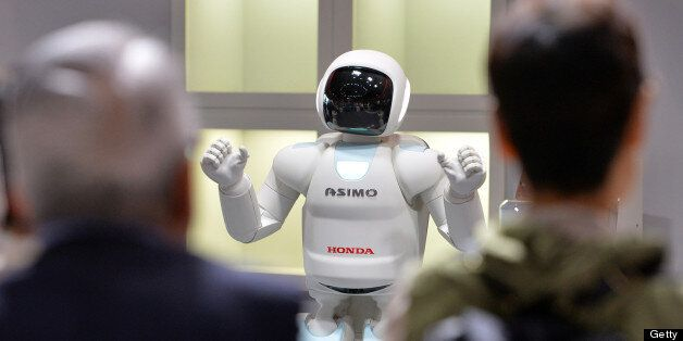 Honda Motor's humanoid robot Asimo interacts with visitors at the National Museum of Emerging Science...