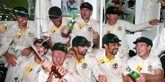 PERTH, AUSTRALIA - DECEMBER 17: The Australian team celebrates victory in the change rooms during day...