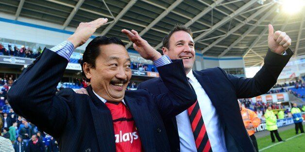 Cardiff City Chairman Vincent Tan (left) and manager Malky Mackay winning the npower Football League
