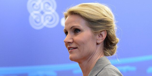 Danish Prime Minister Helle Thorning-Schmidt leaves after the European Union leaders summit on June 28,...