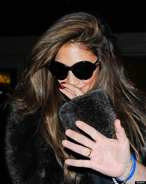 Nicole Scherzinger Receives Police Escort Through LAX Airport, But It Looks Like She's Been