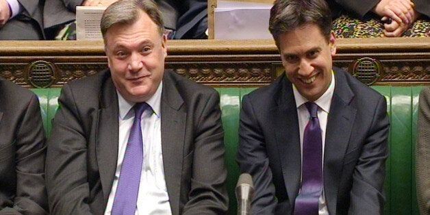 Shadow Chancellor Ed Balls (left) and Labour party leader Ed Miliband listen during Prime Minister's...