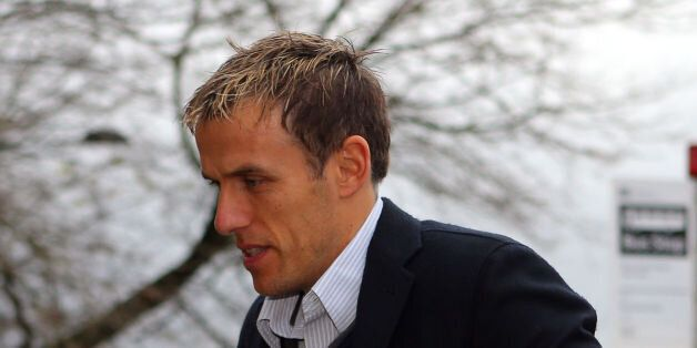 Phil Neville, son of Neville Neville, arrives at Bolton Crown Court where he faces charges of sexual...