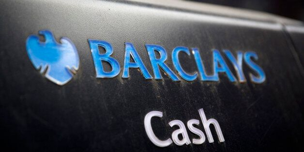 A Barclays logo sits above the word 'Cash' on an automated teller machine (ATM) outside a Barclays Plc...