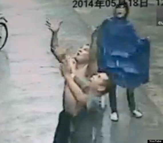 Dramatic Footage Shows Man Catch Baby Falling From 2nd Storey Window In China