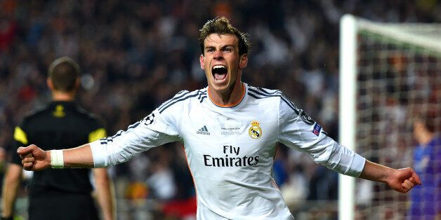 LISBON, PORTUGAL - MAY 24: Gareth Bale of Real Madrid celebrates scoring their second goal in extra time...
