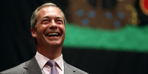 UK Independence Party leader Nigel Farage smiles as he hears the results during the European Parliamentary...