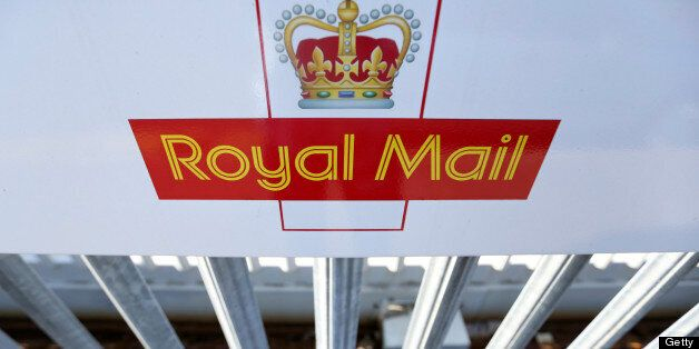 A logo sits on a sign outside Royal Mail Group Ltd.'s postal sorting office in Romford, U.K., on Wednesday,...