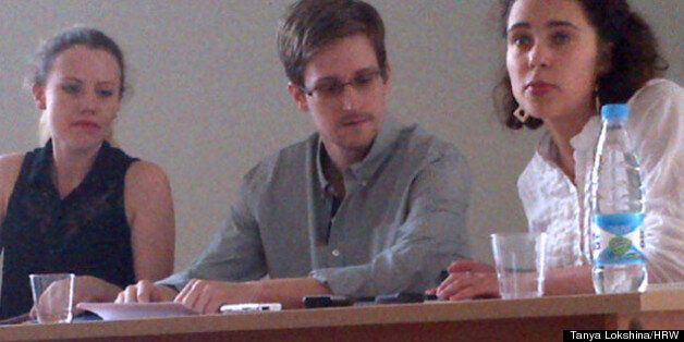 The first picture of Edward Snowden since he fled Hong Kong, with WikiLeaks lawyer Sarah Harrison on...