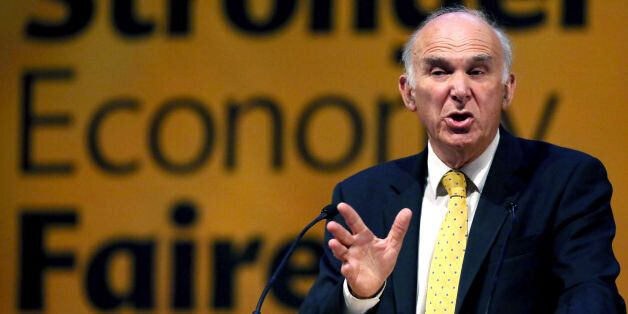 Vince Cable gives a speech after a debate on economy at the Liberal Democrat conference in